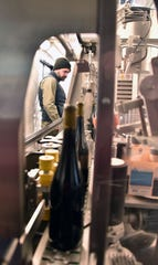 Harbor Hill Mobile Bottling's operations manager Andy Savina operates  mobile bottling in their 38-foot-trailer at Aurora Cellars near Lake Leelanau, Mich. Wednesday, Feb. 12, 2020. A crew bottled 255 cases of red wine for Soul Squeeze, a Lake Leelanau, Mi winery.