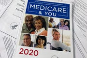 The Official U.S. Government Medicare Handbook for 2020 over pages of a Department of Health and Human Services, Office of the Inspector General report.