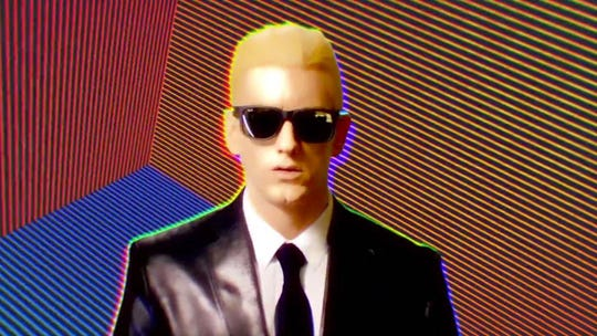 "Eminem as 1980s icon Max Headroom in the ""Rap God"" video."