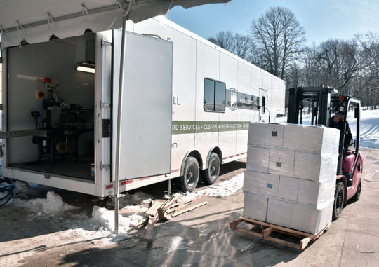 Cases of red wine are moved from the Harbor Hill Mobile Bottling trailer  Wednesday, Feb. 12, 2020, where a crew bottled 255 cases of the wine for Soul Squeeze, a Lake Leelanuau, Mi wintery.