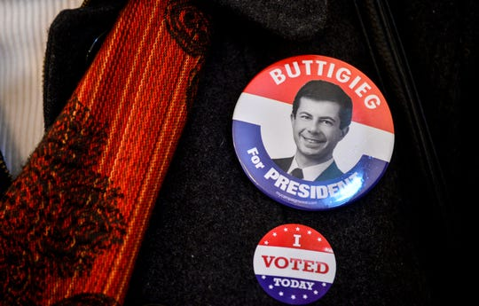 A person wears a button for Democratic presidential candidate, former South Bend, Ind., Mayor Pete Buttigieg, while voting during the New Hampshire presidential primary elections in Chesterfield, N.H., Tuesday, Feb. 11, 2020.