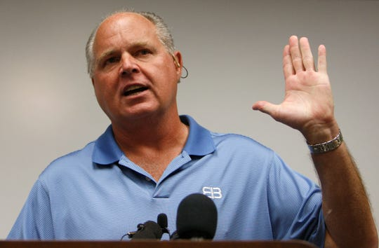 FILE - In this Jan. 1, 2010 file photo, conservative talk show host Rush Limbaugh speaks during a news conference at The Queen's Medical Center in Honolulu.