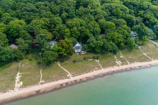 An aerial view of the $1.6 million Saugatuck dream home surrounded by green trees.