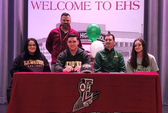 Elmira senior Noah Sperduto signs to play soccer at Le Moyne College on Feb. 13, 2020. Next to him are his parents, Ed and Sarah Sperduto, and Noah's sister, Lindsay. In the back is Elmira boys soccer coach Derek Hamilton.