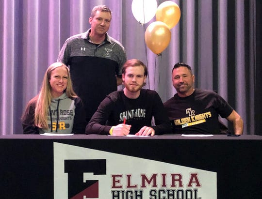 Elmira senior Riley Drake signs to play lacrosse at the College of Saint Rose on Feb. 13, 2020. Next to him are his parents, Jeremy and Ami Drake. In the back is Elmira boys lacrosse coach Jason Stukey.