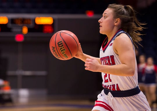 University of Southern Indiana's Addy Blackwell (21) dribbles the ball during the Screaming Eagles game against the Lindenwood University Lions at Screaming Eagles Arena in Evansville, Ind., Thursday night, Feb 13, 2020.