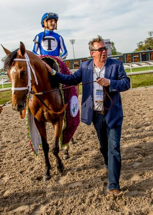 3-23-2019 - Chester Thomas leads By My Standards into the winner's circle after the 106th running of the grade II $1,000,000 Louisiana Derby.