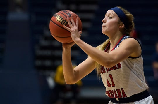 University of Southern Indiana's Morgan Sherwood (11) takes a shot against the Lindenwood University Lions during their game at Screaming Eagles Arena in Evansville, Ind., Thursday night, Feb 13, 2020.