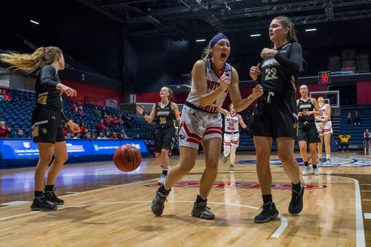 University of Southern Indiana's Morgan Sherwood (11) celebrates a basket made by University of Southern Indiana's Addy Blackwell (21) during their game against the Lindenwood University Lions at Screaming Eagles Arena in Evansville, Ind., Thursday night, Feb 13, 2020.
