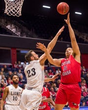 University of Southern Indiana's Tyler Dancy (31) takes a shot over Lindenwood's  Kace Kitchel (23) during their game at Screaming Eagles Arena in Evansville, Ind., Thursday night, Feb 13, 2020.