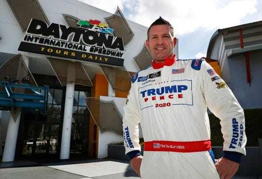 NASCAR Truck Series driver Tim Viens shows off his racing suit at Daytona International Speedway on Monday, Feb. 10, 2020. Viens landed the sponsorship of a pro-President Trump PAC and will drive with the Trump-Pence name on his Chevy in Friday night's race.