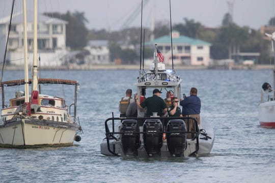 Members from several law enforcement agencies including the Lee County Sheriff's Office, the Coast Guard and the Florida Fish and Wildlife Conservation Commission are investigating a scene on the water just off of Bowditch Point on Fort Myers Beach and at the Coast Guard station on Fort Myers Beach on Friday.