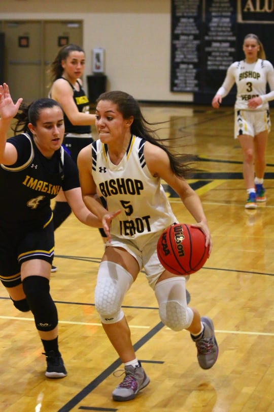 Bishop Verot played host to North Port Imagine School in a girls basketball Class 3A quarterfinal on Thursday, Feb. 13. The Vikings' Catie Reszel drives to the hoop.
