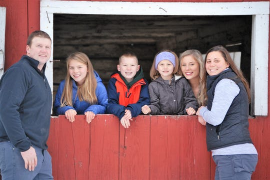 Phil and Laura Finger of Oconto, who recently were named Wisconsin's Outstanding Young Farmers, are seen with their children at their farm at County Line in the town of Little River and the town of Grover in Marinette County. From left are Phil, Alisa (9), PJ (10), Alivia (6), Alana (18) and Laura.