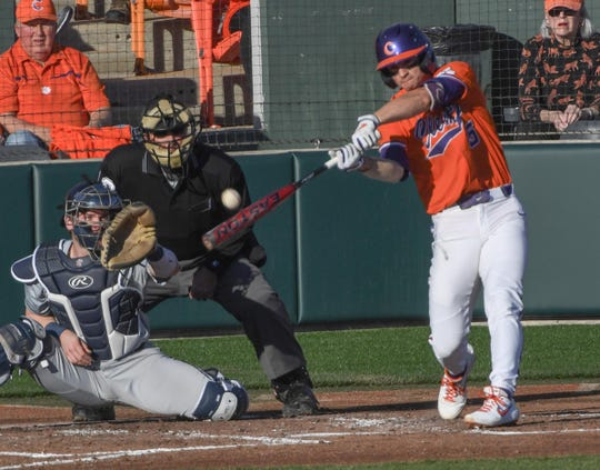 Clemson sophomore Sam Hall(5) bats against Liberty during the bottom of the first inning at Doug Kingsmore Stadium in Clemson Friday, February 15, 2020.