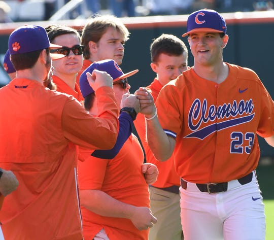 Clemson senior Carson Spiers(23) is introduced before the game at Doug Kingsmore Stadium in Clemson Friday, February 15, 2020.