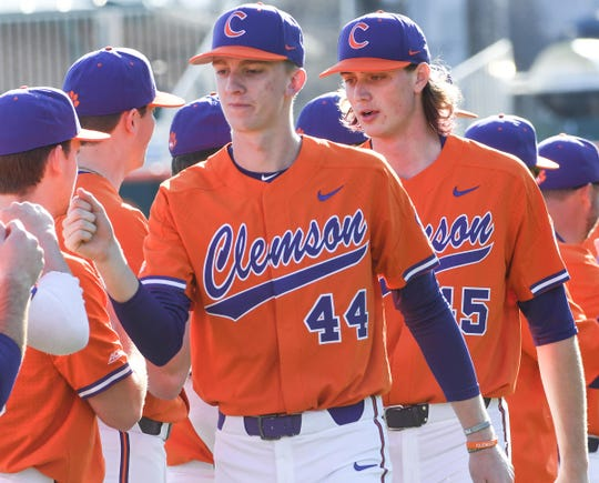 Clemson pitcher Nick Clayton(44) and Clemson pitcher Holt Jones(45) are introduced before the game at Doug Kingsmore Stadium in Clemson Friday, February 15, 2020.