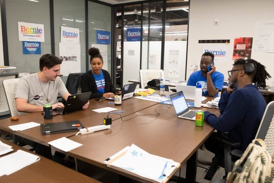 Ben Miles (from left), Tianna Mills, Micah Jenkins and Allen Kagler make calls to spread support of Bernie Sanders at the Bernie Sanders campaign office in Greenville Thursday, Feb. 13, 2020.  Miles and Kagler are volunteers from Greenville, and Mills and Jenkins are Upstate field organizers for the campaign.