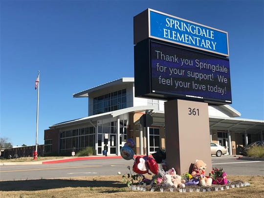 Flowers and teddy bears beneath the Springdale Elementary sign, Feb. 14, 2020. Faye Marie Swetlik was a first-grader at Springdale Elementary School, a part of Lexington School District 2.
