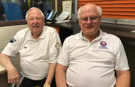 Longtime announcer Bill Harp (left) and MHSA Swimming Rules interpreter Merle Gunderson have been regular fixtures at Great Falls swimming meets for more than 30 years.