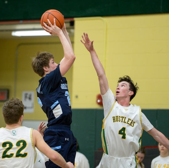 Great Falls High's Drew Wyman attempts a shot as CMR's Raef Newbrough defends during the crosstown basketball game on Thursday in the CMR Fieldhouse.