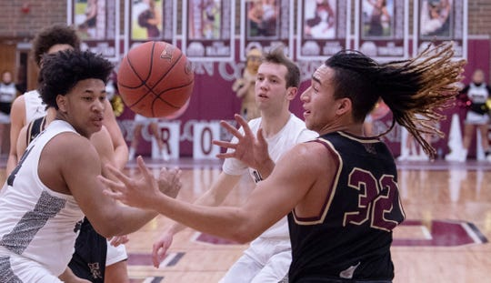 Webster County's Ayden Winn (32) corrals a rebound against Henderson's defense at Henderson County High School Thursday night.