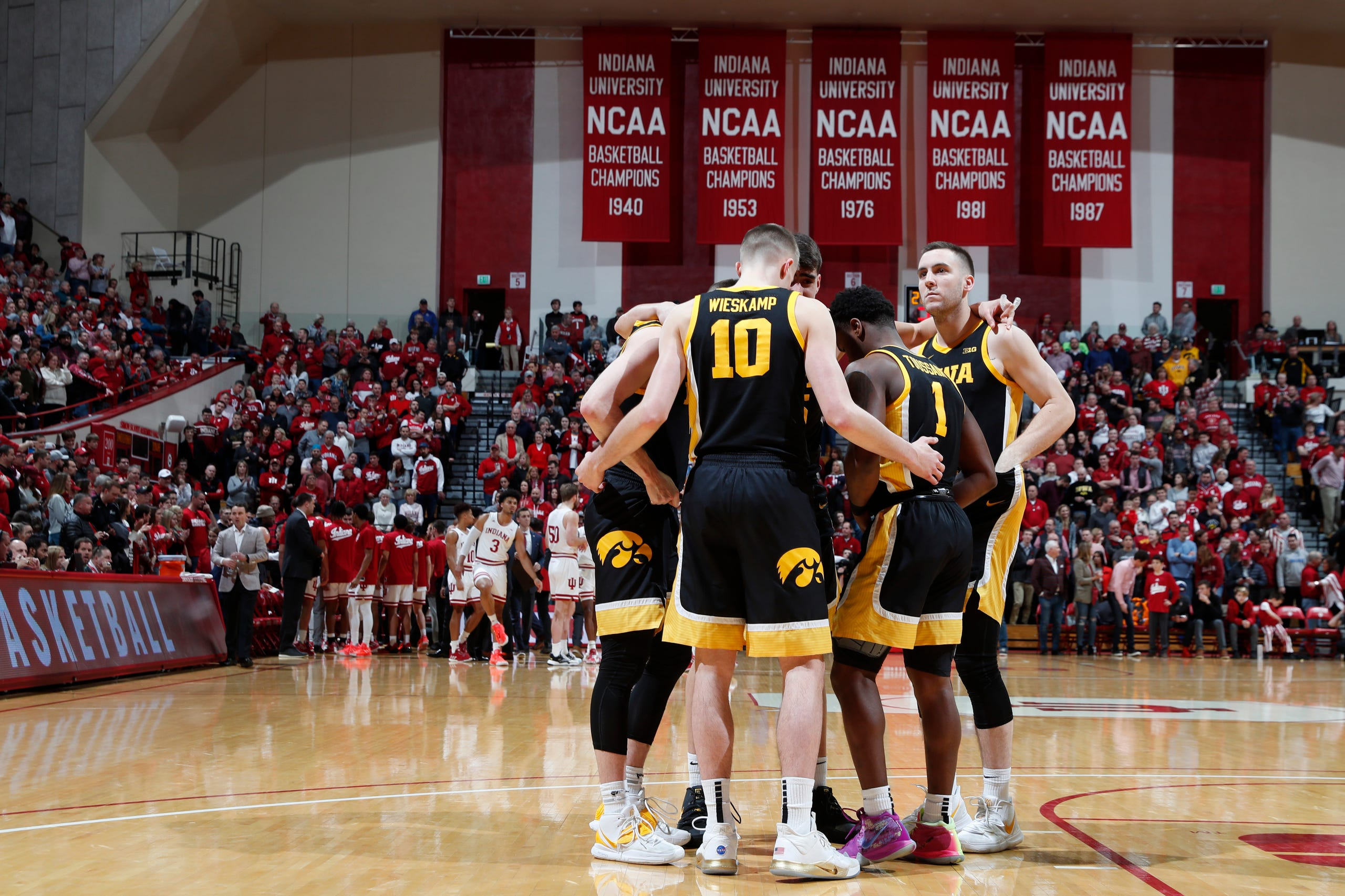 Feb. 13, 2020; Bloomington, Indiana, USA; Iowa Hawkeyes huddle up on the floor before the game against the Indiana Hoosiers at Simon Skjodt Assembly Hall.