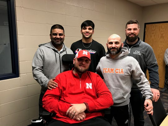 Team CIA presented Eric Allred with a $20,000 check on Wednesday. Allred, father of Shenandoah senior wrestler Silas Allred, is batting ALS. Standing: Gurpartap Gill, Silas Allred, Brady Eppert, Chad Ulmer. Seated: Eric Allred.