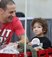 IndyCar drivers Tony Kanaan smiles with Severus Hansonafter giving him a Valentine's card and sticker at Riley Hospital for Children in Indianapolis on Friday, Feb. 14, 2020.