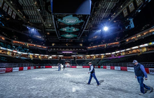 Members of the CINCH show walk across the arena during a sound check at Bankers Life Fieldhouse, Indianapolis, Friday, Feb. 14, 2020. The Fieldhouse goes under a transformation preparing for CINCH World's Toughest Rodeo by pulling up the basketball court, laying down dirt and cattle shoots.