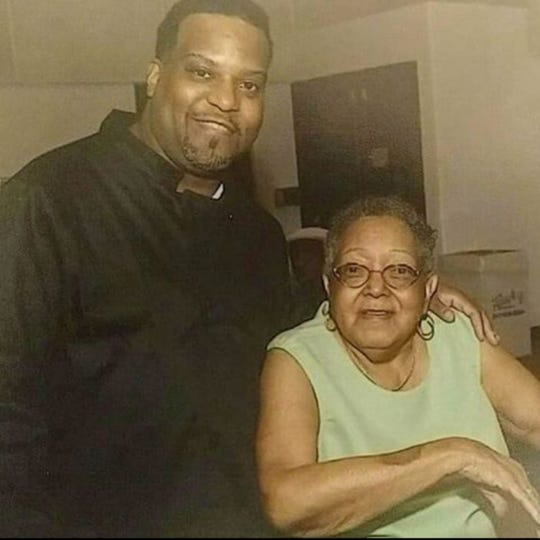 SouthPaw Catering chef/founder Ali Foster stands by his grandmother, Effie Harris,  in this photo snapped of the two before Harris died. Foster was inspired to become a chef by memories of his grandmother's cooking and how her food and kindness brought family and friends together.