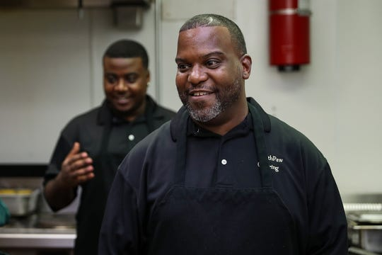 SouthPaw Catering founder and chef Ali Foster and his son, Tommy Hart, work together during Foster's weekly Friday night fish-fry pop-ups at at Fay Biccard Glick Neighborhood Center in Indianapolis.