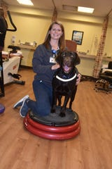 Katlynne Ray, PT, DPT, and her therapy dog, Ava.