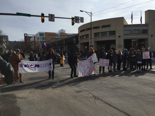 A protest shut down traffic at the intersection of Green Street and Cayuga Street on Feb. 12, 2020.