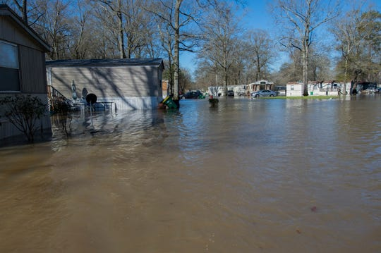 Homes in Harbor Pines Mobile Home Community in Ridgeland are surrounded by rising floodwater early Friday, Feb. 14, 2020. On Thursday, Mayor Gene Magee ordered the mandatory evacuation due to the rising waters of the Pearl River and the expected crest of 38 feet on Sunday.