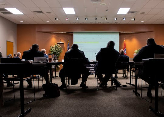 Commissioners hold discourse at a Madison County Commission meeting at Jackson-Madison Health Department in Jackson, Tenn., Friday, Feb. 14, 2020.