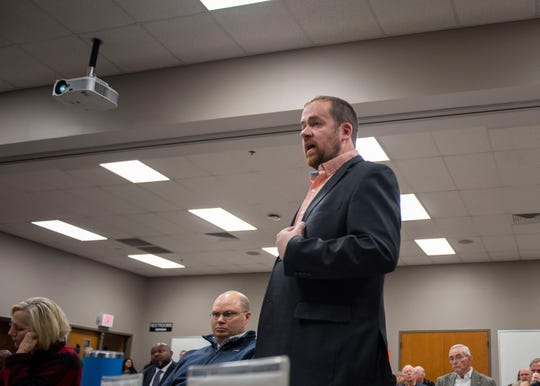 County Commissioner Jason Compton introduces the idea of a wheel tax to fund a new Pope Elementary School and the public-private partnership to build a renovated Jackson Central-Merry High School on Friday, Feb. 14, 2020.