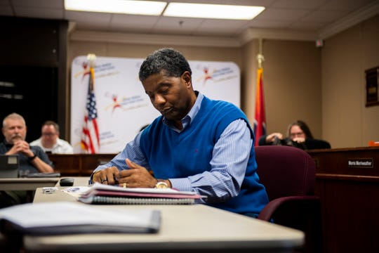 District 1 School Board Chairman James Johnson looks over his notes during a special school board meeting at Jackson-Madison County Board of Education in Jackson, Tenn., Monday, Feb. 10, 2020.