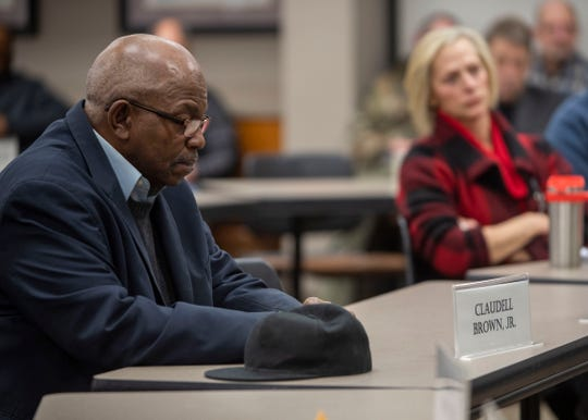 County Commissioner Claudell Brown listens during a debate  about the wheel tax Friday, Feb. 14, 2020.