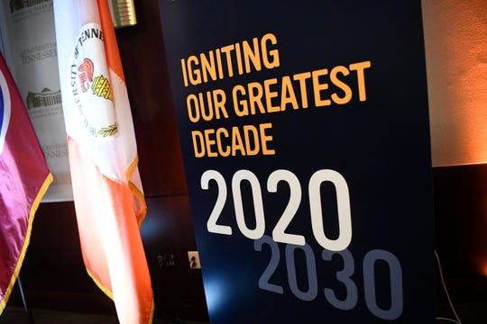 A sign is set out as University of Tennessee Interim President Randy Boyd speaks at the annual State of the University address on Friday.