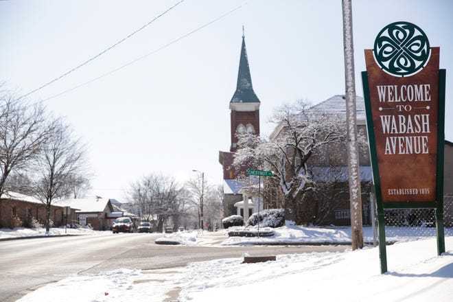 """St. Ann's Catholic Church is seen in the background of a """"Welcome to Wabash Avenue"""" sign along Wabash Avenue, Friday, Feb. 14, 2020 in Lafayette."""