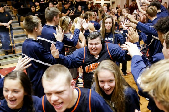 Harrison's Tommy Sonderath goes through the fan tunnel before an IHSAA unified basketball game against McCutcheon, Friday, Dec. 20, 2019 in Lafayette.