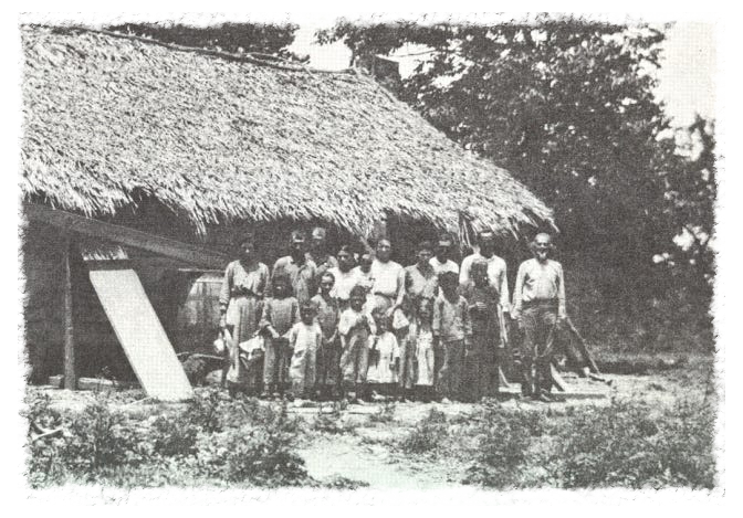Houma Indians in Terrebonne Parish in 1907. These houses are similar to those built and lived in on Isle De Jean Charles, residents say. United Houma Nation tribe members still live on the island and in surrounding areas.