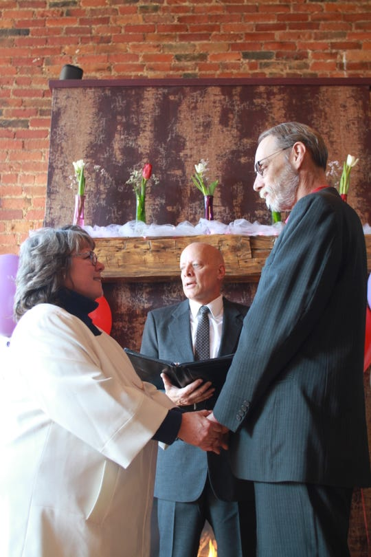 Bill Fenton, who is an ordained minister, officiated the wedding of Denise Morgan, of Brighton, and Thomas Walker, of Ann Arbor, on Friday Feb. 14, 2020 at Uptown Coffeehouse in Howell. Fenton has officiated free weddings on Valentine's Day at the business since they started being hosted there in 2016.