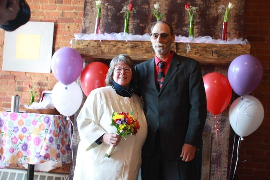 Brighton resident Denise Morgan, 58, and Thomas Walker, 56, from Ann Arbor, were married Friday, Feb. 14, 2020 at Uptown Coffeehouse in Howell. The business has hosted free weddings on the holiday that are officiated by Bill Fenton.