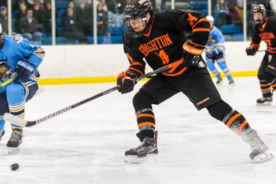 Brighton's Del Wohlart plays the puck in a 4-0 loss to Livonia Stevenson in the KLAA hockey championship game on Thursday, Feb. 13, 2020 at Eddie Edgar Ice Arena.