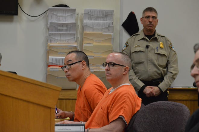 Glenn Chin (left) and Barry Cadden (right) listen to testimony in a preliminary hearing on Feb. 13, 2020 in Livingston County.