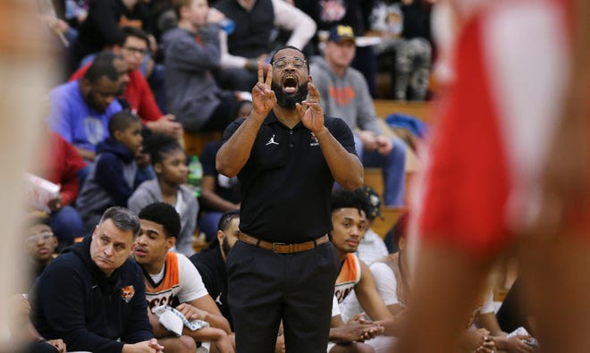 Fern Creek head coach James Schooler, III shouts instructions to the team against Butler during their game at Fern Creek High School in Louisville, Ky. on Feb. 13, 2020.