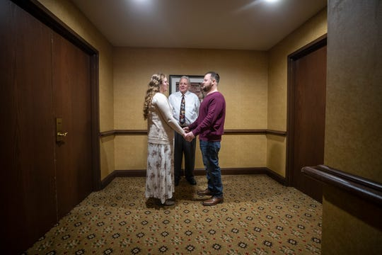 Julie Hall and Lute Burgett chose Valentine's Day to get married. Justice of the Peace Gary Fields conducted the ceremony between two convention halls at the Crowne Plaza Hotel on Feb. 14, 2020.