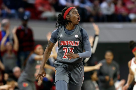 Louisville guard Jazmine Jones (23) reacts following a basket against North Carolina State during the second half of an NCAA college basketball game in Raleigh, N.C., Thursday, Feb. 13, 2020.